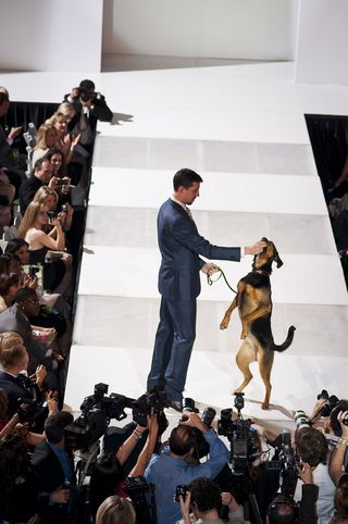 Top Male Fundraiser Joe Robert III with his dog Kali on the Runway